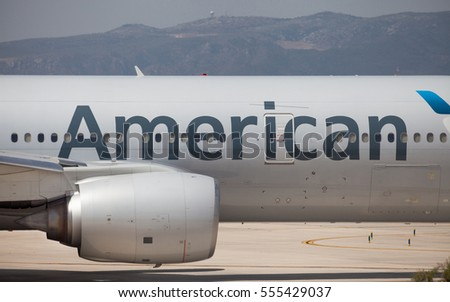 Barcelona, Spain - July 30, 2016: Engine and fuselage of an American Airlines Boeing 777-200ER on runway prior to take off from El Prat Airport in Barcelona, Spain.