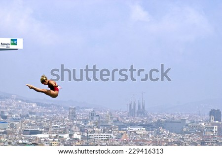 BARCELONA, SPAIN-JULY 14, 2003: italian Tania Cagnotto in action during the final of the Swimming World Championship, with the Gaudi cathedral in the back, in Barcelona.