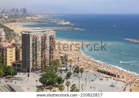 Barcelona, Spain - June 6, 2011: Barcelona is the 2nd largest city in Spain and a hugely popular tourist destination. Here: bird's eye view on Barceloneta beach and the Balearic Sea.
