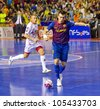 BARCELONA, SPAIN - JUNE 17: Sergio Lozano (9) of FCB in action at Spanish Futsal League final match between FC Barcelona and El Pozo Murcia, final score 4 - 1, on June 17, 2012, in Barcelona, Spain. - stock photo