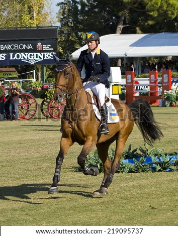 BARCELONA, SPAIN - SEPTEMBER 25: Cassio Rivetti from Ukraine rides Verdi at the 100th CSIO event at the Real Club de Polo Barcelona, on September 25, 2011, in Barcelona, Spain.