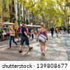 BARCELONA, SPAIN - SEPTEMBER 21: La Rambla on September 21, 2012 in Barcelona, Spain. Thousands of people walk daily by this popular pedestrian area 1.2 kilometer-long - stock photo