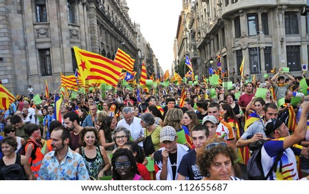 BARCELONA, SPAIN - SEPTEMBER 11: Participants in the rally for the independence during the National Day of Catalonia on September 11, 2012 in Barcelona, Spain, where participated 1,5 million people