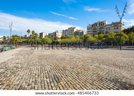 BARCELONA, SPAIN - SEPTEMBER 15. Pedestrian zone Plaza Muelle del Rellotge as part of Port Vell and the Barceloneta district Barcelona on September 15, 2016. Thousands of people stroll every day along