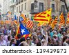 BARCELONA, SPAIN - SEPTEMBER 11: Up to a million people converge on Barcelona to join a rally demanding independence for Catalonia, on September 11, 2012, in Barcelona, Spain. - stock photo