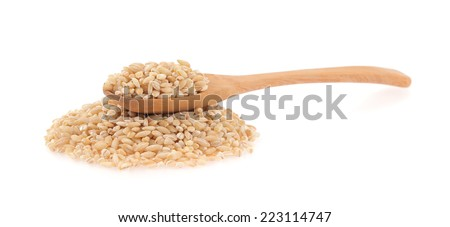 Barley in a wooden spoon isolated on white background