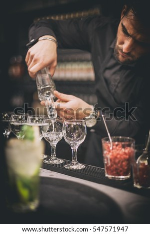 Barman at work, preparing cocktails