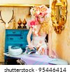 baroque fashion blonde housewife woman with iron chores - stock photo