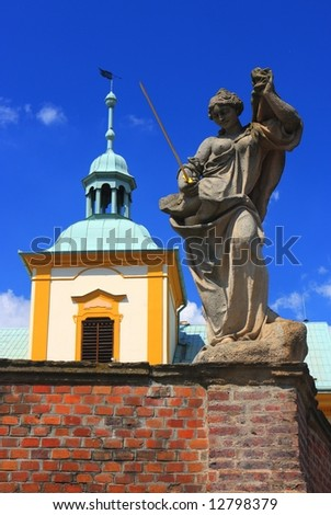 Baroque statue and church tower at Manetin, Czech republic, Bohemia, Czechoslovakia, Central Europe