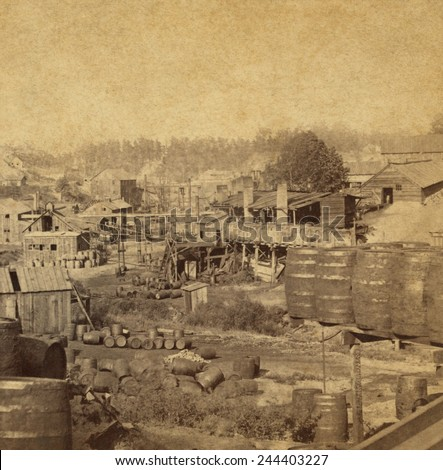 Barrels and buildings at an oil refinery in Erie, Pennsylvania in the 1870s.