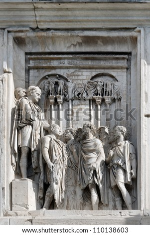 Bas-relief with the image of the emperor who is s off in a military campaign. Fragment of furniture of a triumphal arch of Constantine. Rome. Italy.