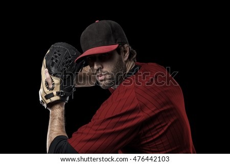 Baseball Player with a red uniform on a black background.