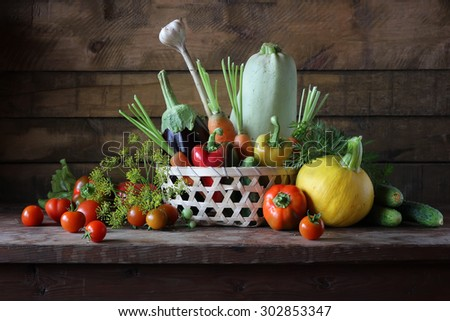 Basket with vegetables: vegetable marrow, pumpkin, eggplant, pepper, carrots, cucumbers and tomatoes. Vegetables in a basket.
