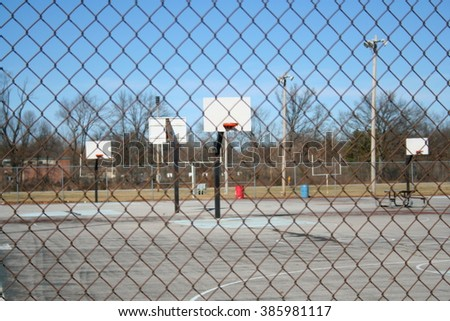 Basketball Court Through a Fence