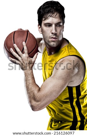 Basketball player on a  yellow uniform, on a white background.