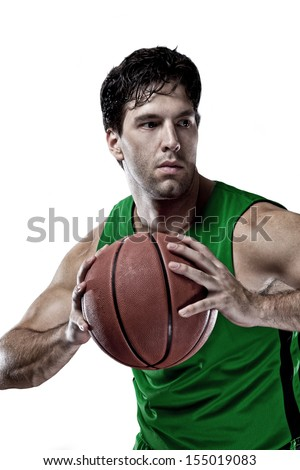 Basketball player with a ball in his hands and a Green uniform. On a white Background
