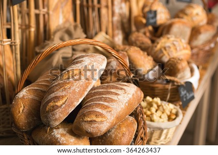 baskets of bread on a shelf, in a bakery store