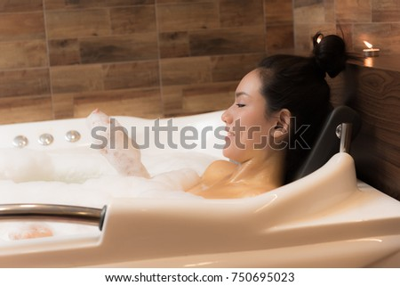 Young pretty woman taking bubble bath stock photo 244188460 shutterstock - Relaxing japanese bathroom design for ultimate relaxation bath ...