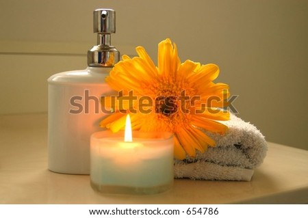 bathroom accessories and burning candle
