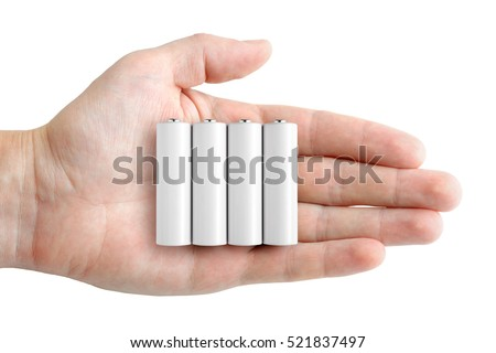 Batteries in hand isolated on white background