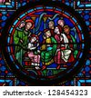 BAYEUX - FEBRUARY 12: Stained glass window depicting The Finding in the Temple, an episode in the early life of Jesus depicted in the Gospel of Luke in Honfleur, France, on February 12, 2013. - stock photo