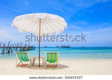 Beach Chair With The White Beach Umbrella On A Beautiful Sandy Beach  Overlooking The Bridge And