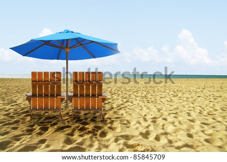 Beach chairs on perfect tropical golden sand beach
