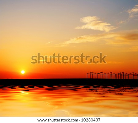 beach hut with a beautiful sunset