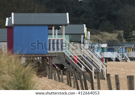 beach huts on stilts in the county of norfolk