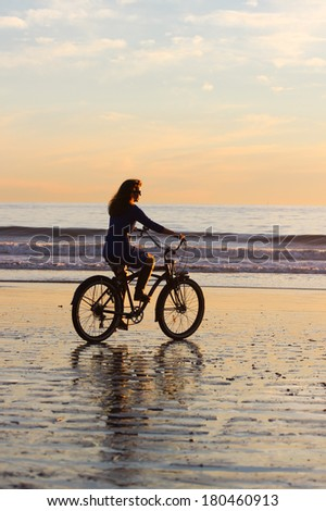 beach sunset bike ride silhouette