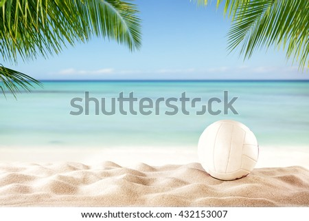 Beach volleyball ball on sandy beach with copyspace for text