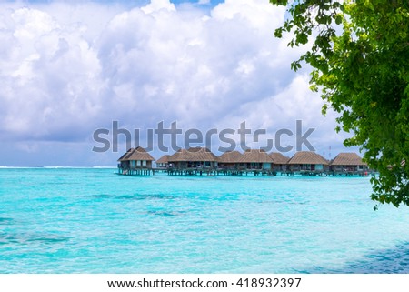 Beach with water bungalows at Maldives.