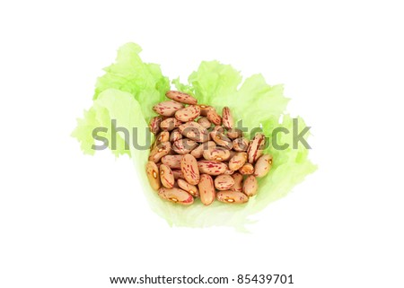 Beans on lettuce leaf, isolated on white
