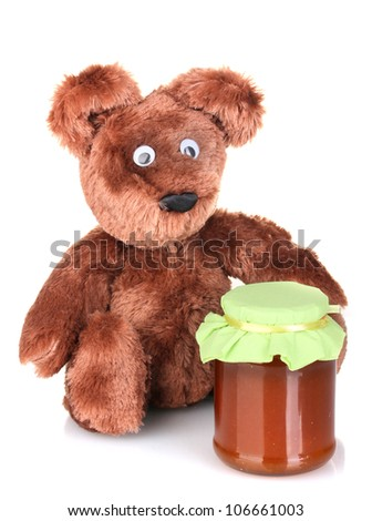 Bear toy and sweet jam isolated on white