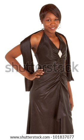 Beautiful African American Lady in a beautiful evening dress is looking at the camera.