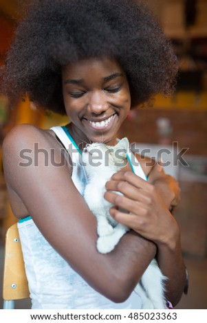 Beautiful afro american  woman with a cat