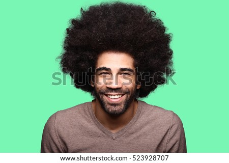 Beautiful afro man in front of a colored background