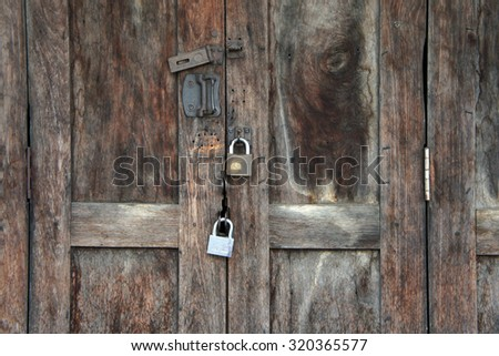 Beautiful ancient wooden door with metal lock texture background.