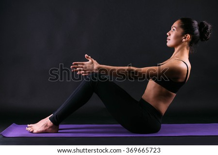 Beautiful and athletic black girl doing stretching