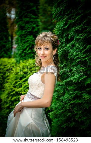 Beautiful angelic bride outdoors