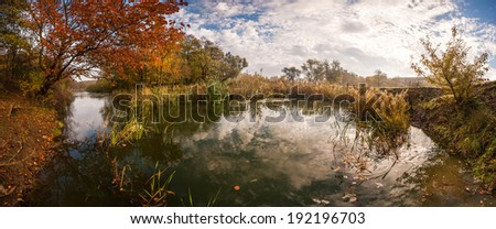Beautiful autumn landscape, sky reflection in water