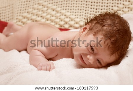 Beautiful baby in towel after bathing