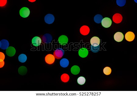 beautiful background of different color lights on the black