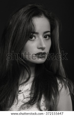 Beautiful black and white portrait of a young woman