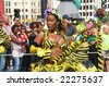Beautiful black carnival dancer with Bee theme at the Caribbean carnival parade in Rotterdam on July 26. - stock photo
