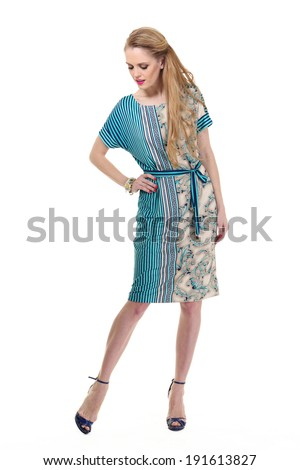 beautiful blond fashion business woman model in summer dress isolated on white