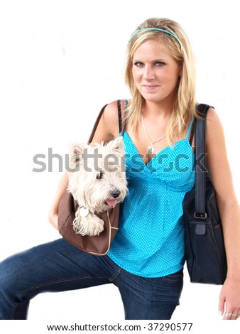Beautiful blond girl holding a dog on white background