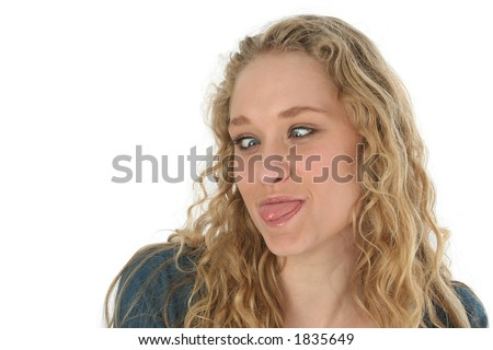 Beautiful blond girl sticking out her tongue and crossing her eyes.