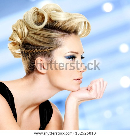 Beautiful blond woman with fashion  hairstyle and blue eye makeup