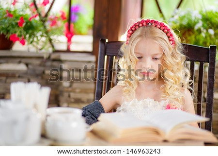 beautiful blonde girl reading an interesting book